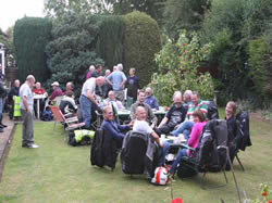 The riders and passengers enjoying tea and cakes