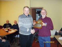 Dave McMahon receives the Chairman's award from chairman Harry Wiles.