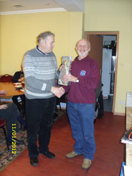 Dave Mac receives a bottle on behalf of son John