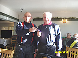 Frank Parker receives a packet of chocolate buttons from the organiser, Bob Taylor, for the scruffiest bike.